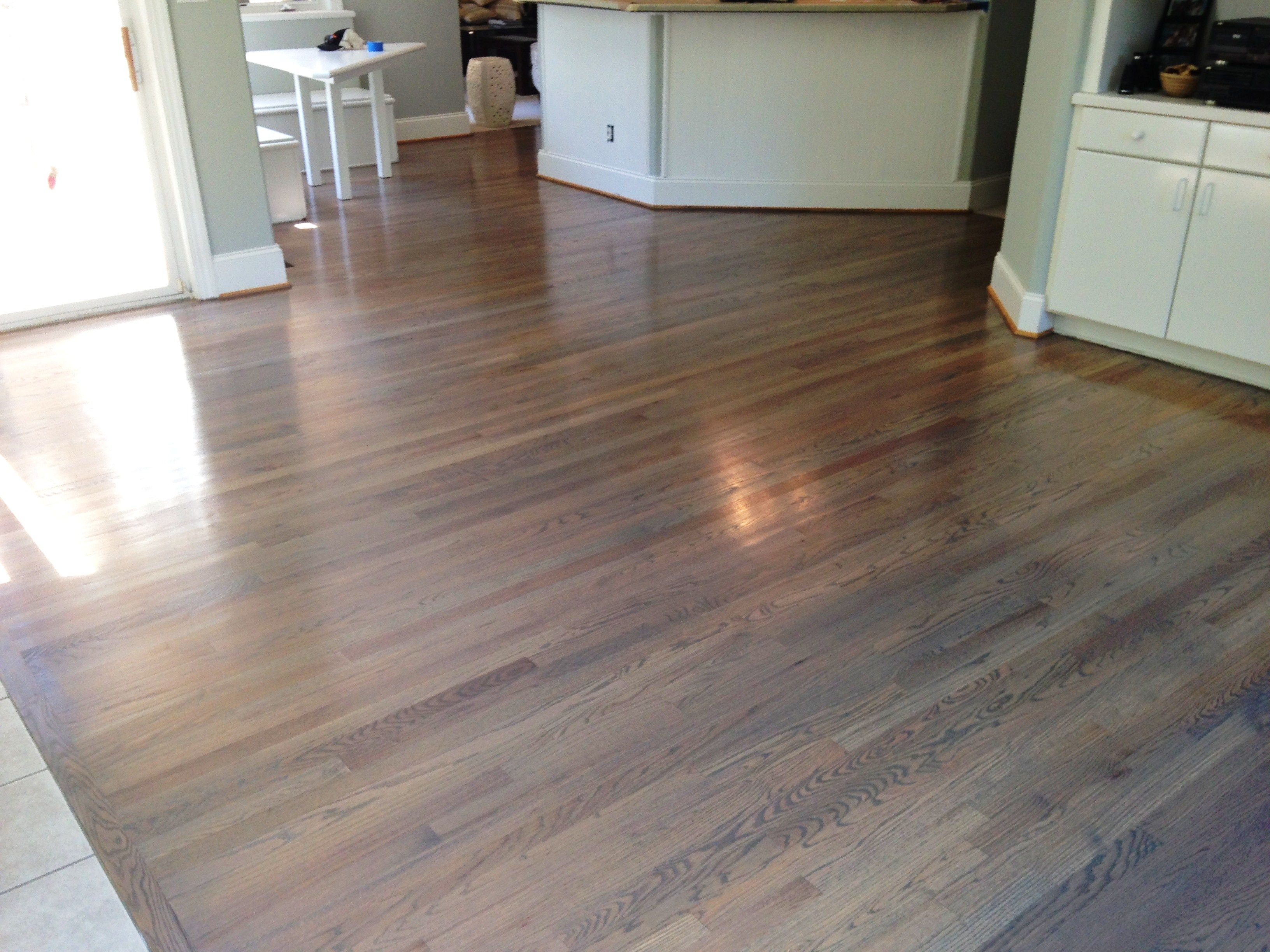 Natural white oak Hardwoods refinished in a custom color Included