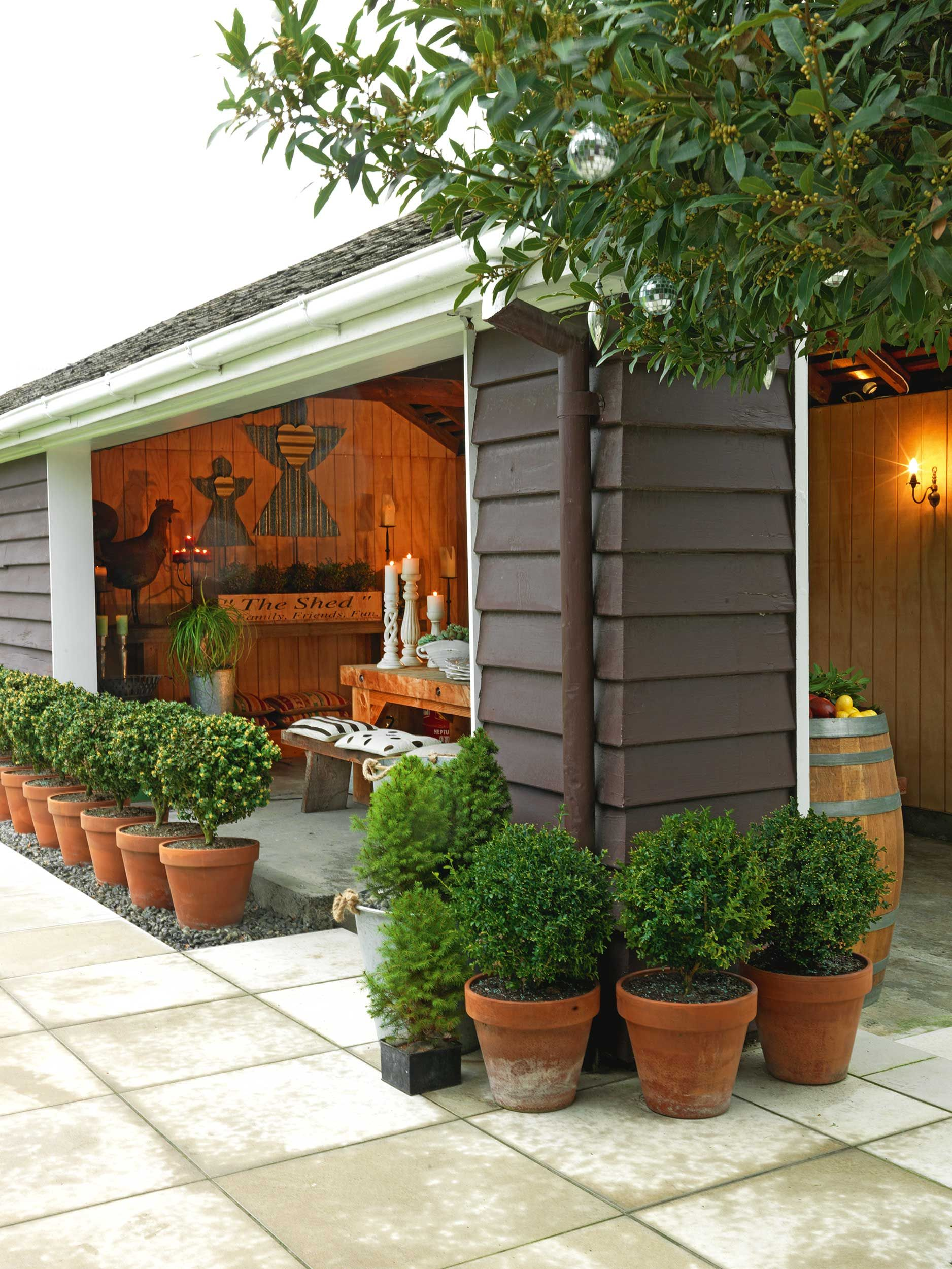 Old garage converted into indoor outdoor room country for Pinterest outdoor garden rooms