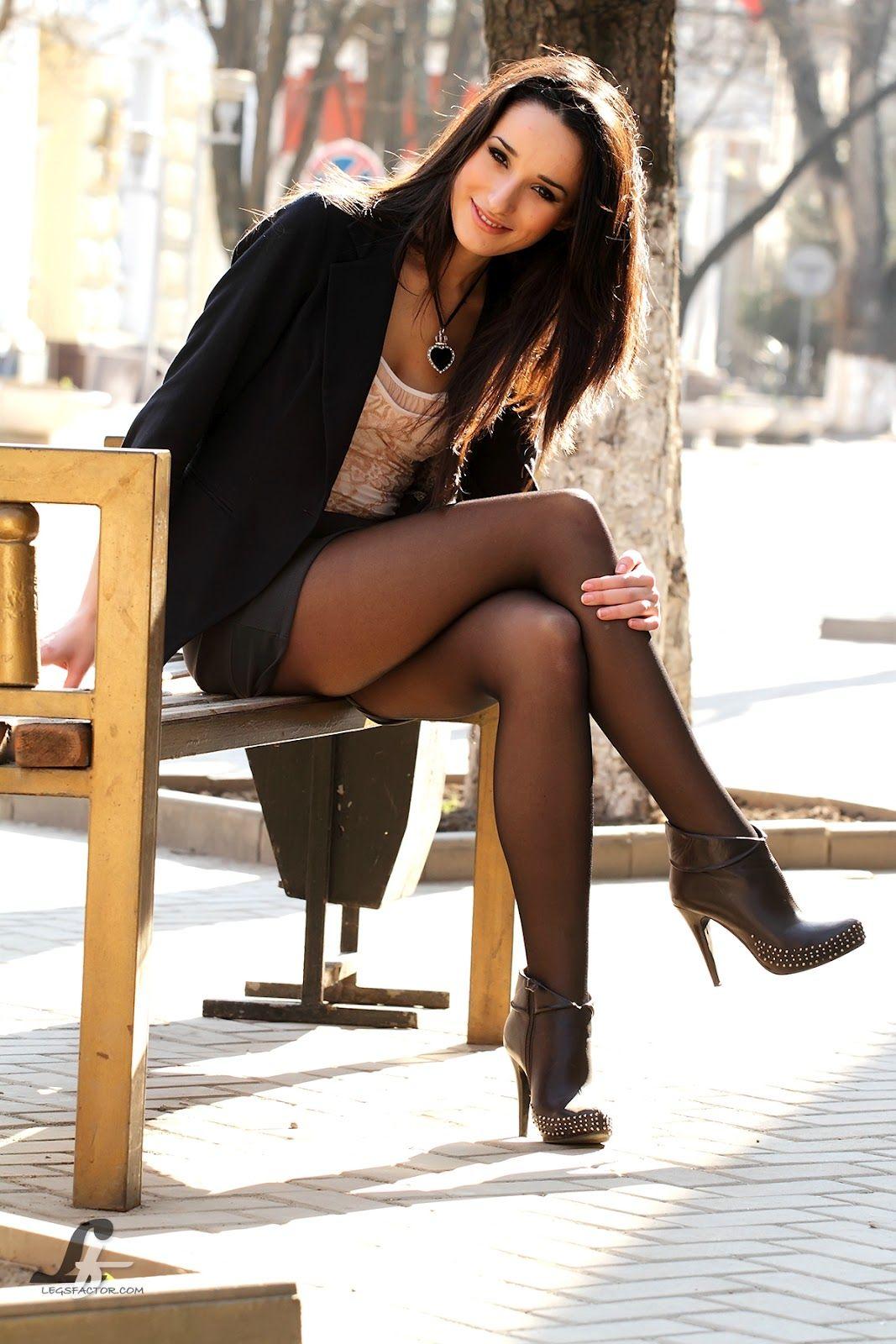 Brilliant  Pretty Woman In White Sweatshirt And Short Black Skirt And HeelsJPG