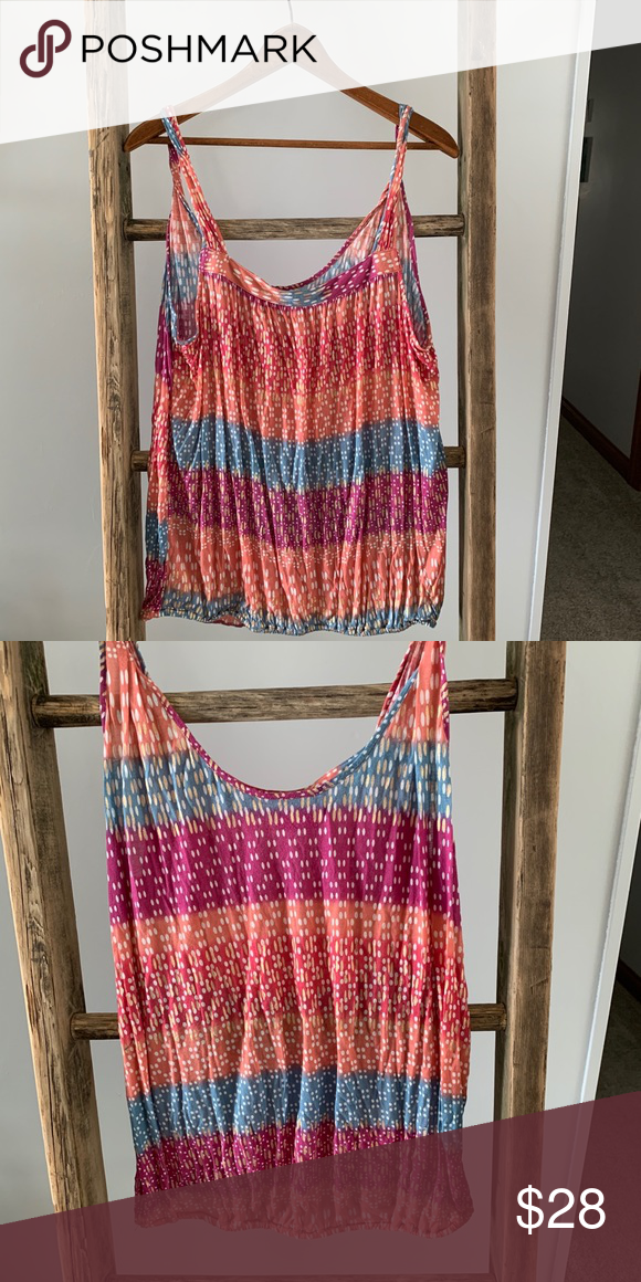 🎉5 for 50🎉 Free People tank Excellent used condition. No signs of wear.  Vibrant colors, elastic hem...