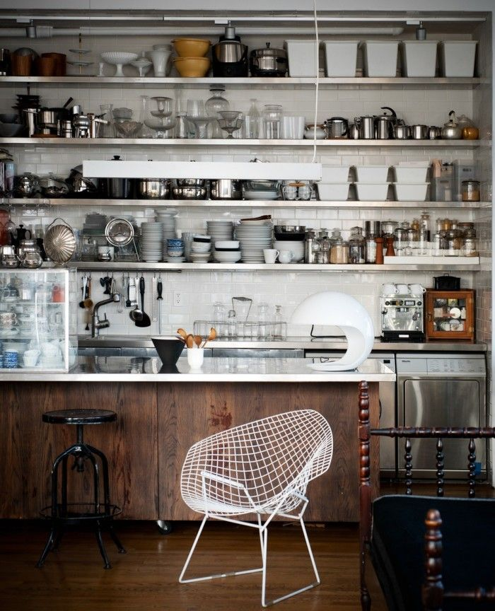 Industrial stainless steel and dark wood kitchen in NYC loft apartment, #bertoia chair