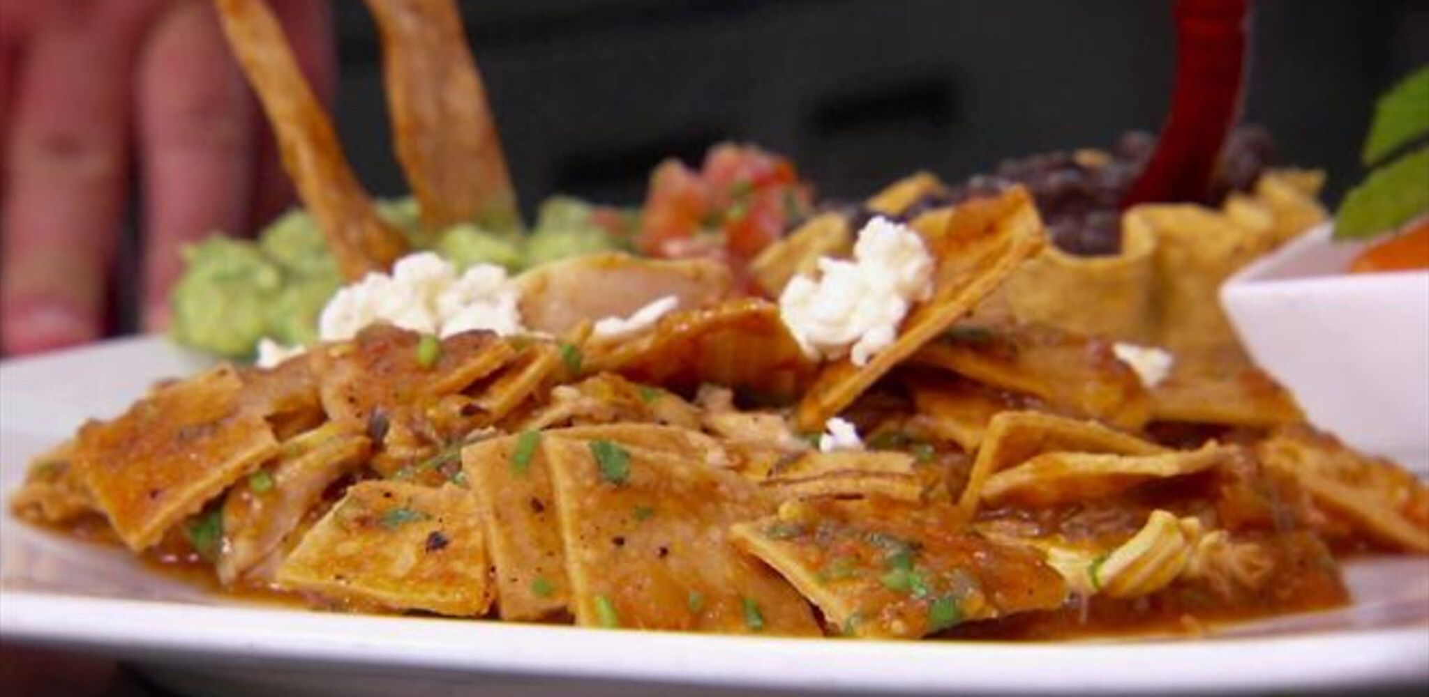 Chilaquiles rojos traditional mexican breakfast dish