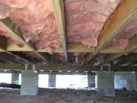 This Pier Foundation Supports A Raised Floor Framed With Pressure Treated Lumber And Insulation Between The Joists
