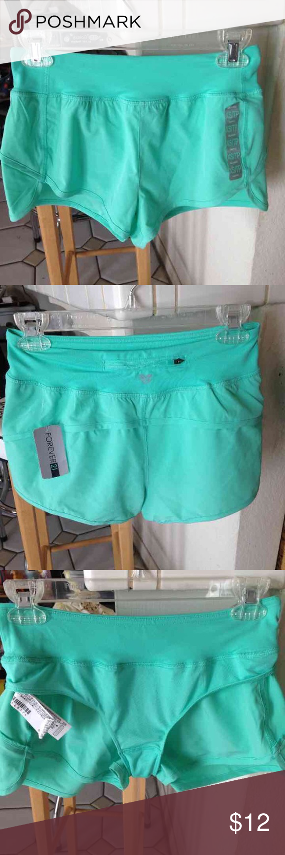 Teal Aqua Speed Shorts Size XS, fit true to size. These have been worn once! The tags were taken off. There is a small spot on the front the seller did not warn me about, it's not noticeable but just letting you know about it. 😊 Forever 21 Shorts
