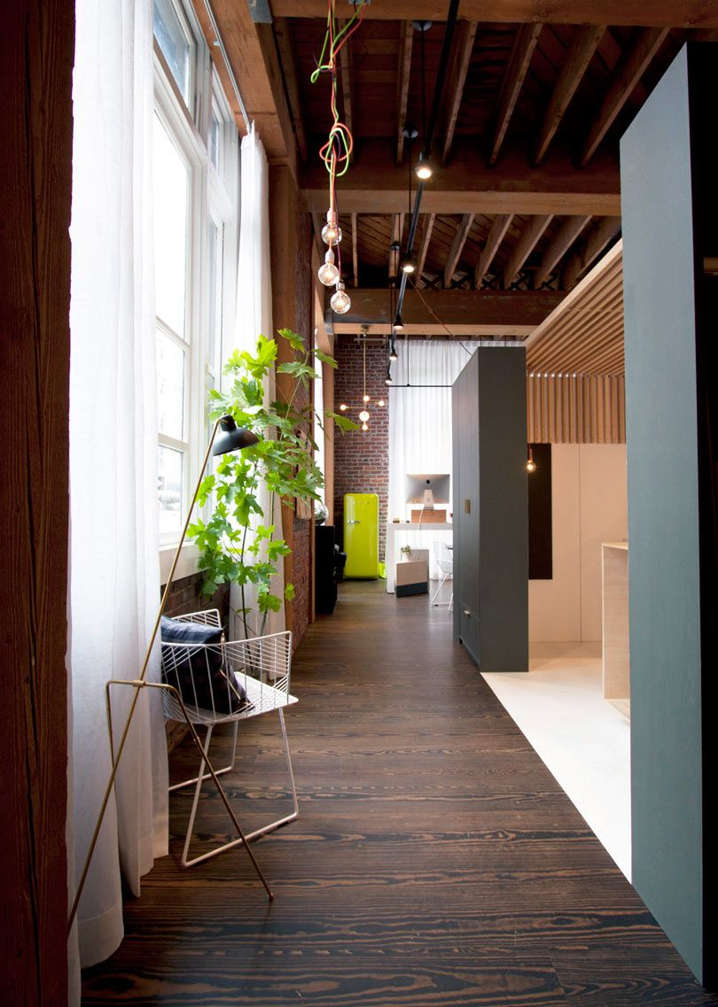 design studio with high wood ceilings, brick and lovely old windows