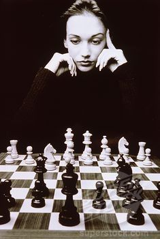 Young Woman Playing Chess Game Stock Photo 1830 26486 Superstock Idea Pinterest Tableros De Ajedrez Ajedrez Jaque Mate