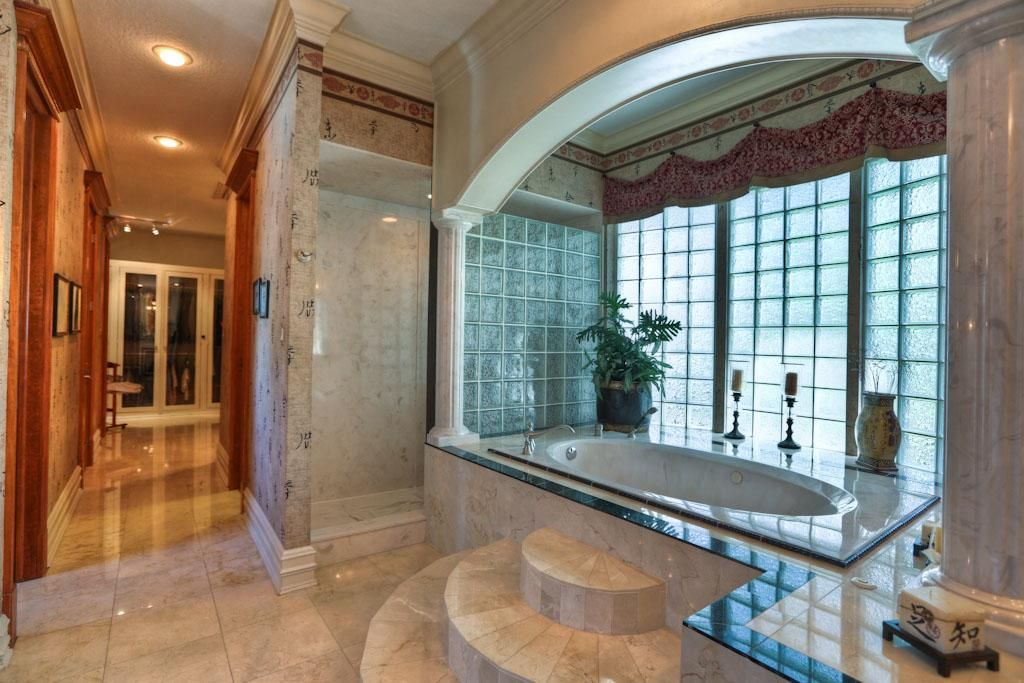 Master bath with a relaxing Jacuzzi tub , Bidet, Double Sinks and