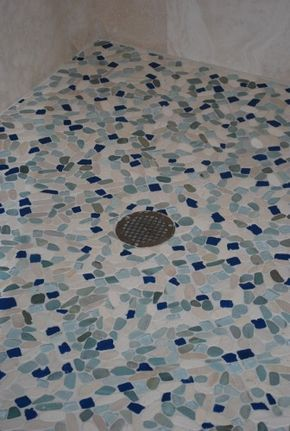 sea glass with pebbles, used to tiled a shower floor