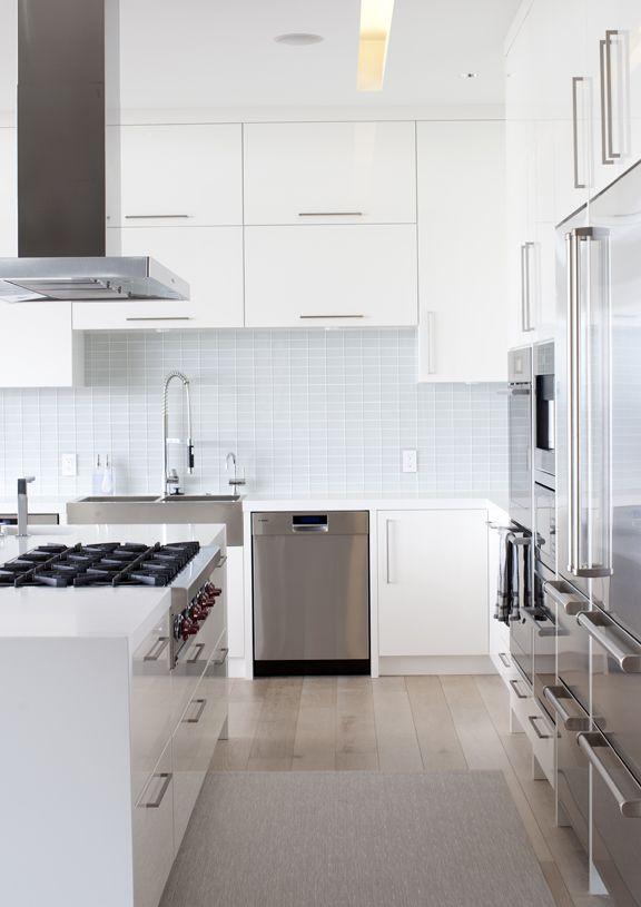 modern white kitchen looks like a 36 wolf rangetop