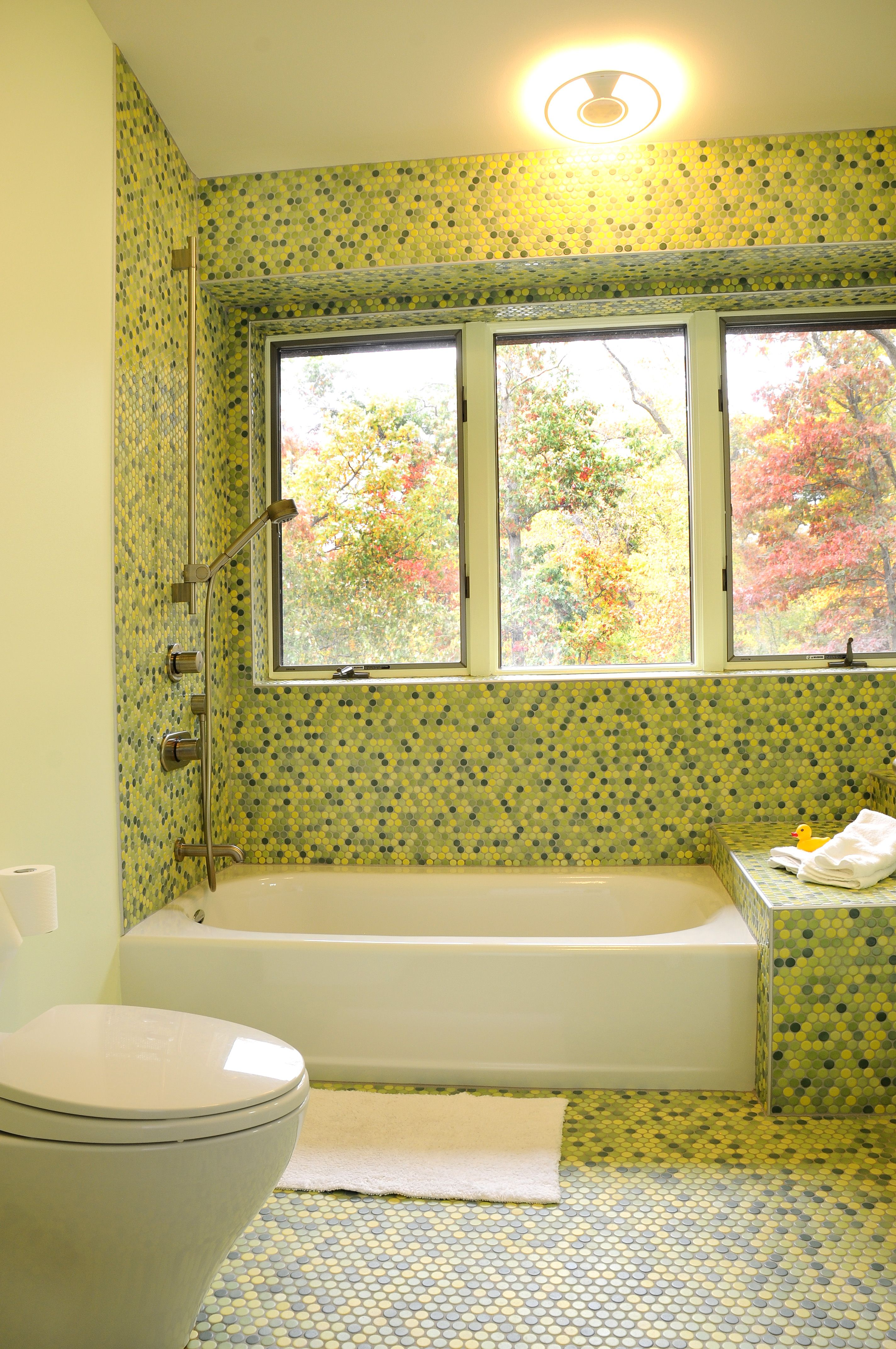 bathroom with green circle tile walls and flooring love