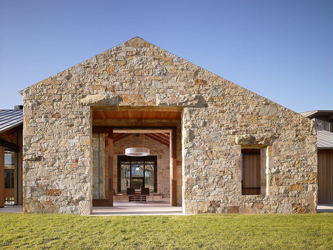 contemporary but looks ancient. protected outdoor area, asymmetrical roof.