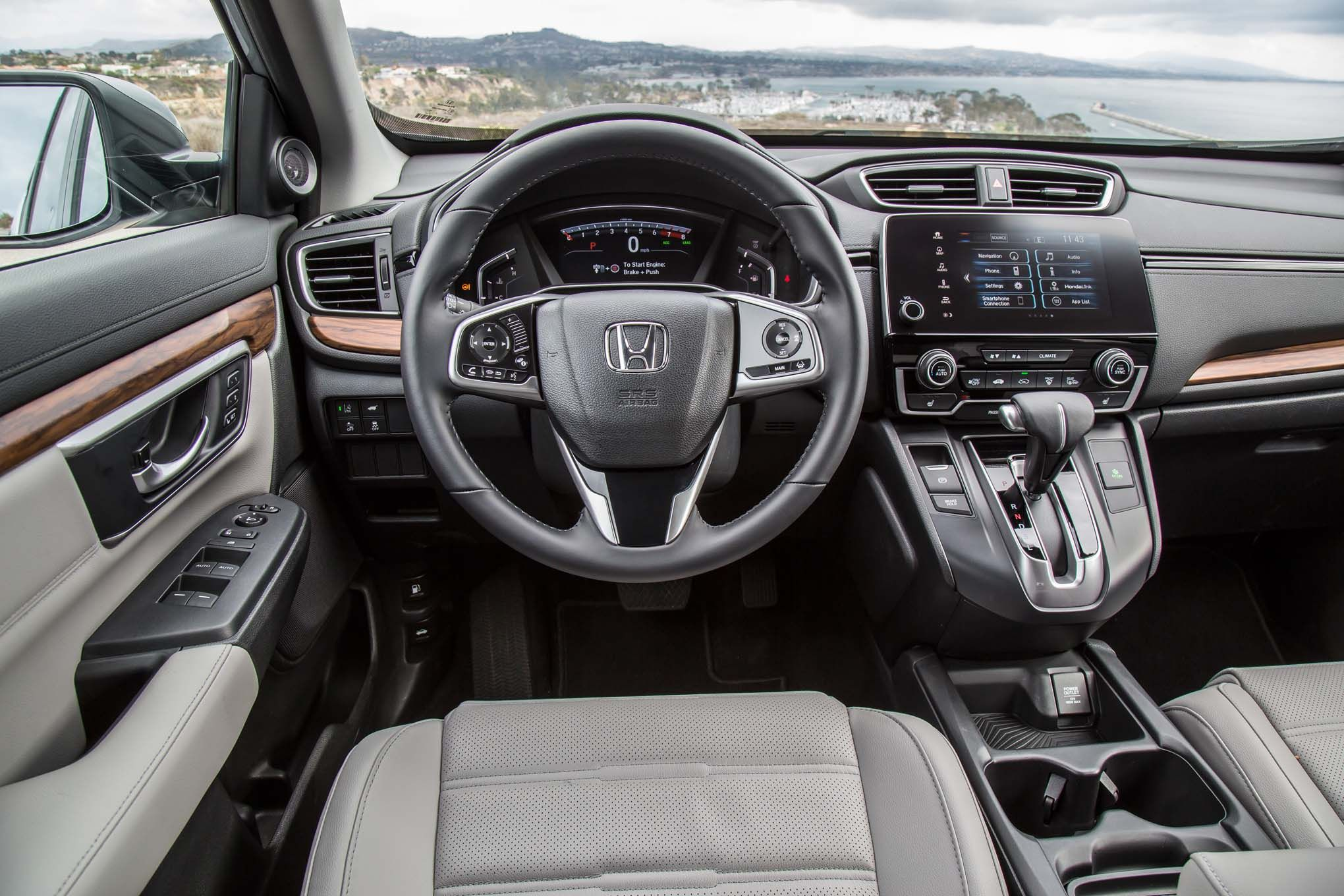 http://st.motortrend.com/uploads/sites/5/2016/11/2017-Honda-CR-V-Touring-AWD-cockpit.jpg