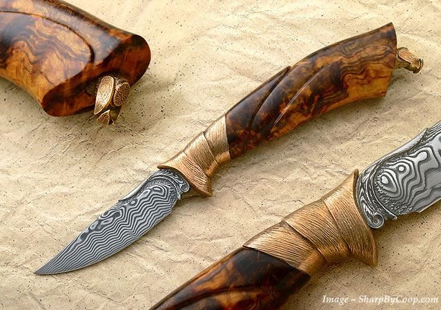 Broadwell build this trout knife for his good friend and fellow fly fisherman, Ray Cover. It features a full range of carving on the stainless damascus blade, bronze guard and swivel bale, and stabilized rhododendron burl handle. The knife will completely disassemble by unscrewing the finial. Yes, Cover has taken it fishing! It is for a great friend, so it's priceless!