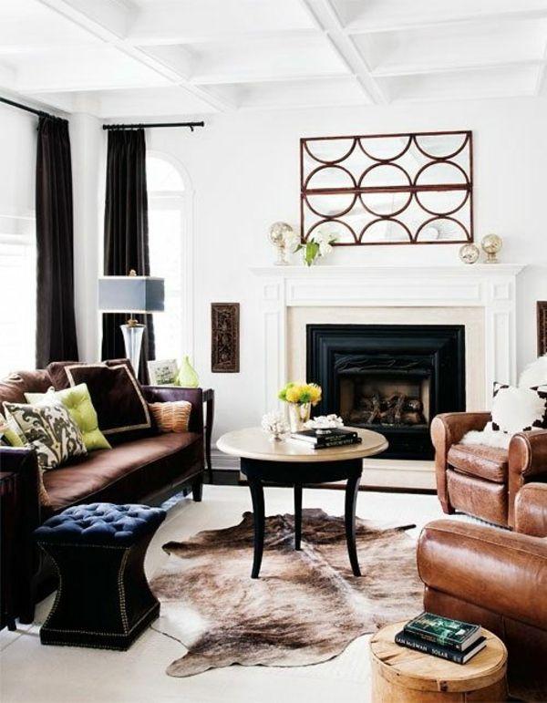 kuhfell teppich verlegen schwarz wei wohnzimmermbel ledersessel - Wohnzimmermobel Weis