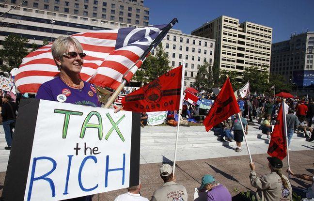 http://img.20mn.fr/GGs1op3jRzCu9lpziOuNiw/648x415_manifestante-porte-panneau-imposons-riches-washington-6-octobre-2011.jpg
