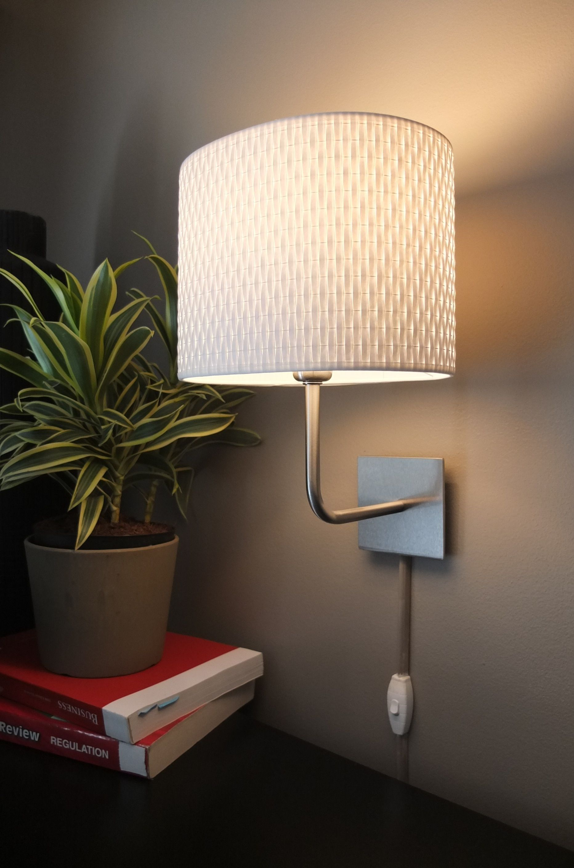 Wall mounted IKEA lamps are an easy way