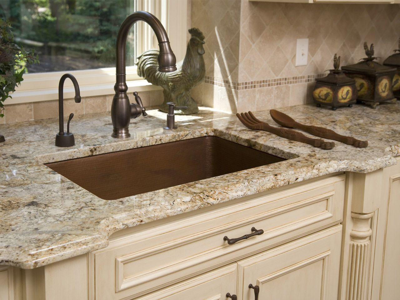 Kitchen Detail Cream Glazed Cabinets With Giallo Ornamental Granite Countertops Love The Faucet Color Of The Countertops