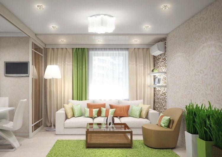 Wohnzimmer in Grün und Beige mit natürlichem Ambiente Möbel