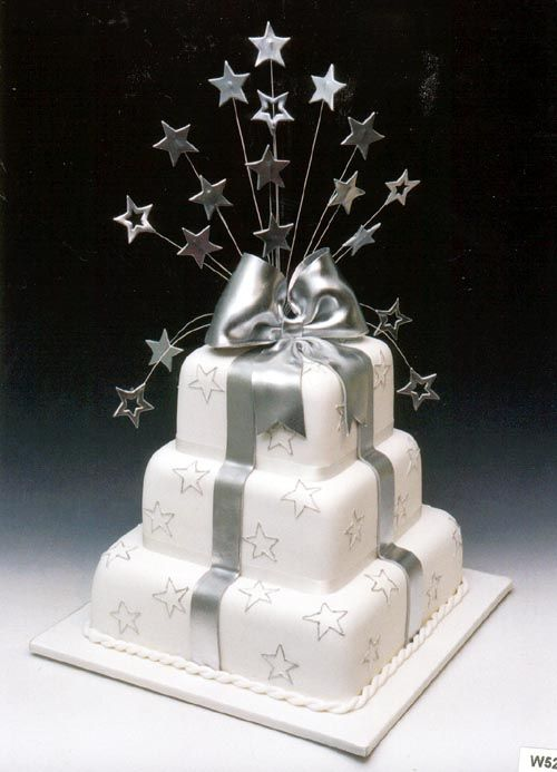 Celebration cake with silver bow and stars. By Cakes by Eve