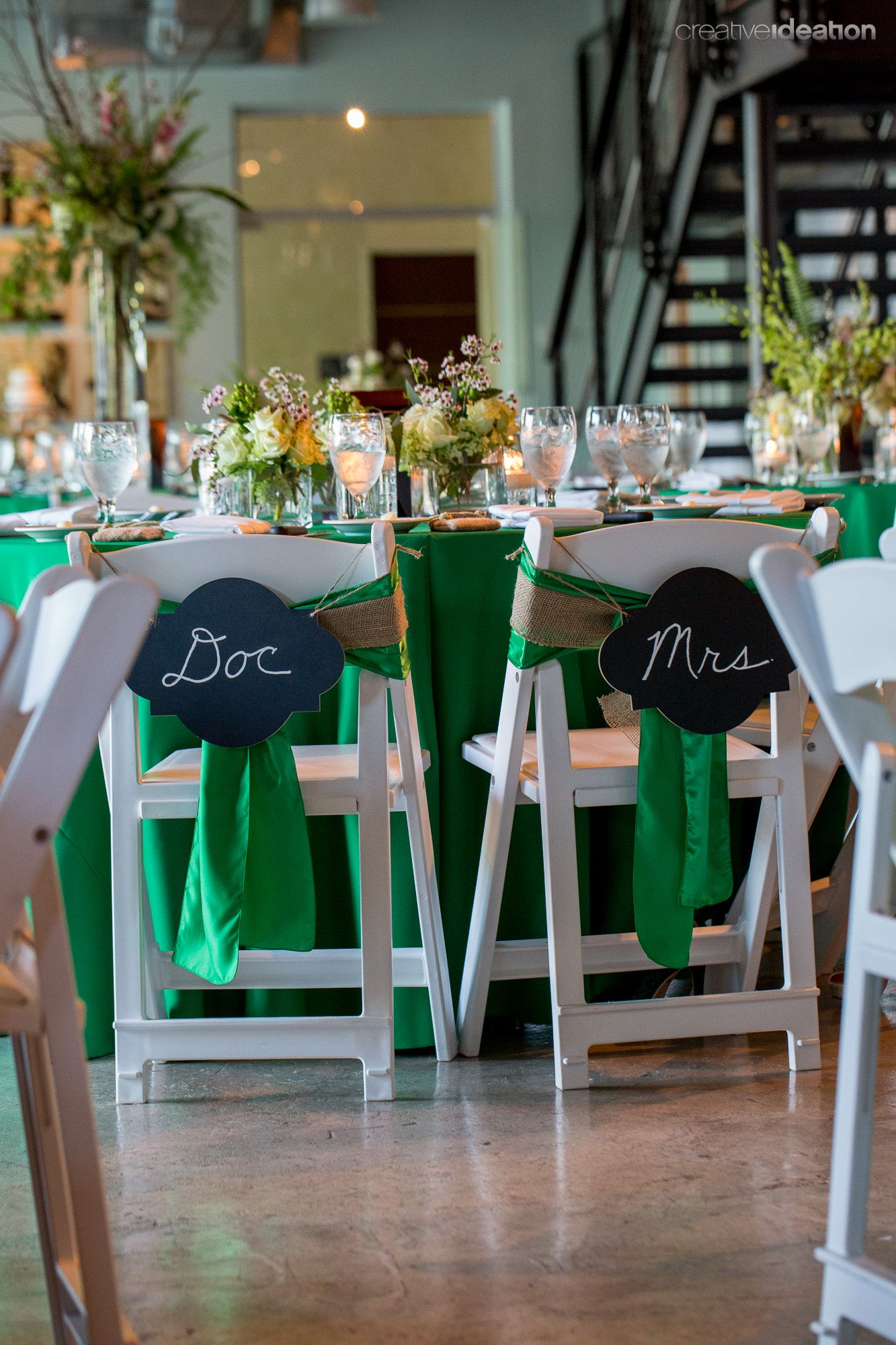 Emerald and wildflowers chalkboard chair ties for the bride and