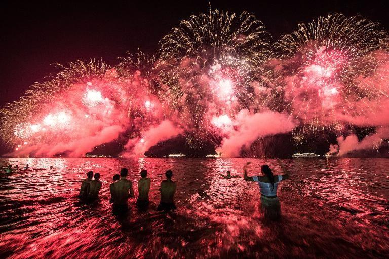 Ushering In The New Year Around The Globe Holidays Around The World Amazing Destinations New Year Fireworks