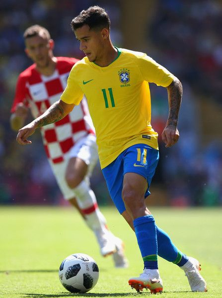 Philippe Coutinho Photos - Philippe Coutinho of Brazil runs the ball during the International friendly match between of Croatia and Brazil at Anfield on June 3, 2018 in Liverpool, England. - Philippe Coutinho Photos - 3 of 1667