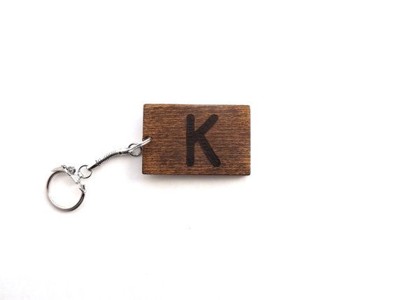 Looking for a personalized gift? This unique wood keychain can be personalized with the initial of your choice and can be customized with the stain of your choosing. #handmade #giftideas #personalizedgifts #woodkeychains #personalizedkeychains #initals #names