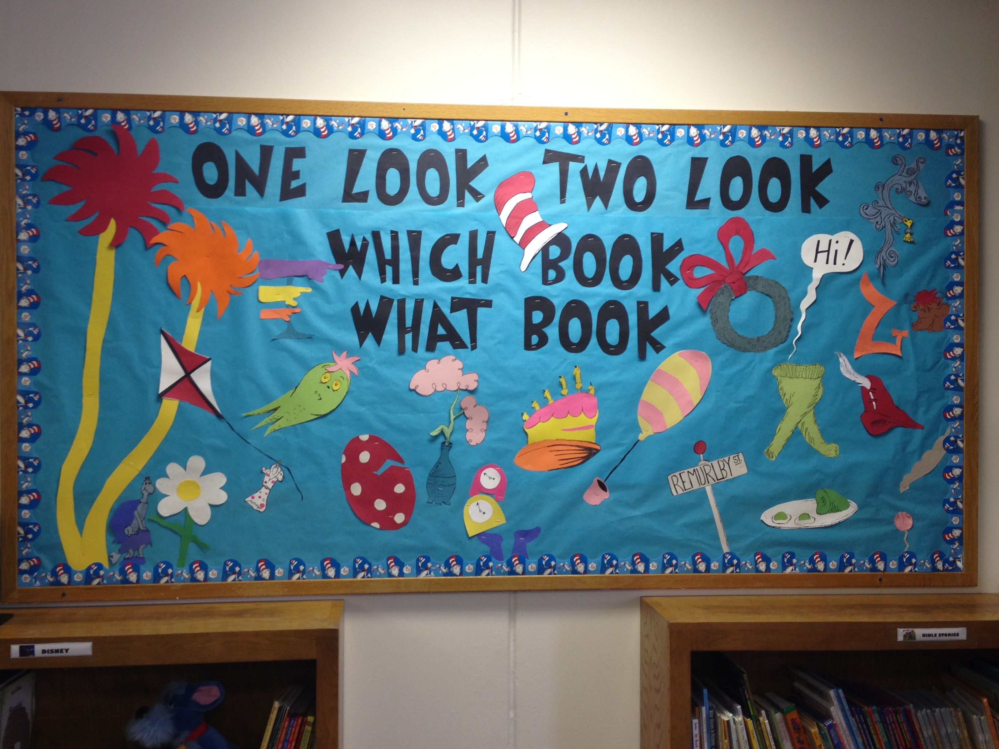 Love this idea our st john 39 s library dr seuss bulletin for Cork board displays