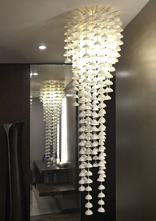 The lovely susurrus ceramic sculpture chandelier chandeliers susurrus ceramic sculpture chandeliermade from bone china bells which set off different sounds when aloadofball Images