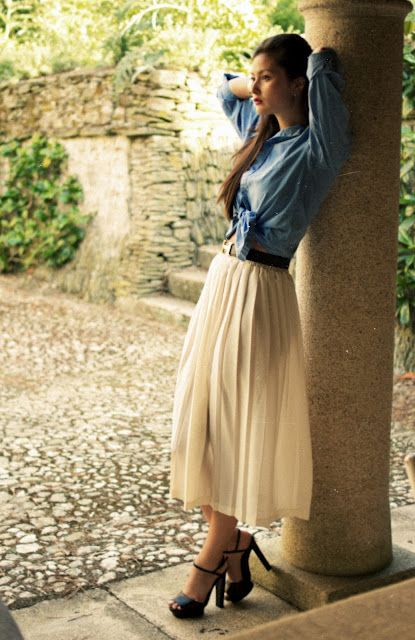 Pair your denim shirt with a flowy white skirt to create this chic ensemble.