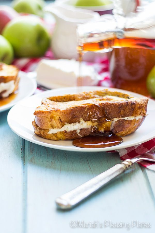 This Apple Cheesecake French Toast with Maple Cider Syrup is a perfect brunch dish! Decadent slices of buttery brioche in a cinnamon batter, stuffed with a spiced apple and cream cheese filling topped with a homemade maple cider syrup.