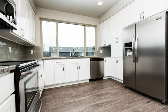 Kitchen view 3 featuring a large window, stainless steel ...
