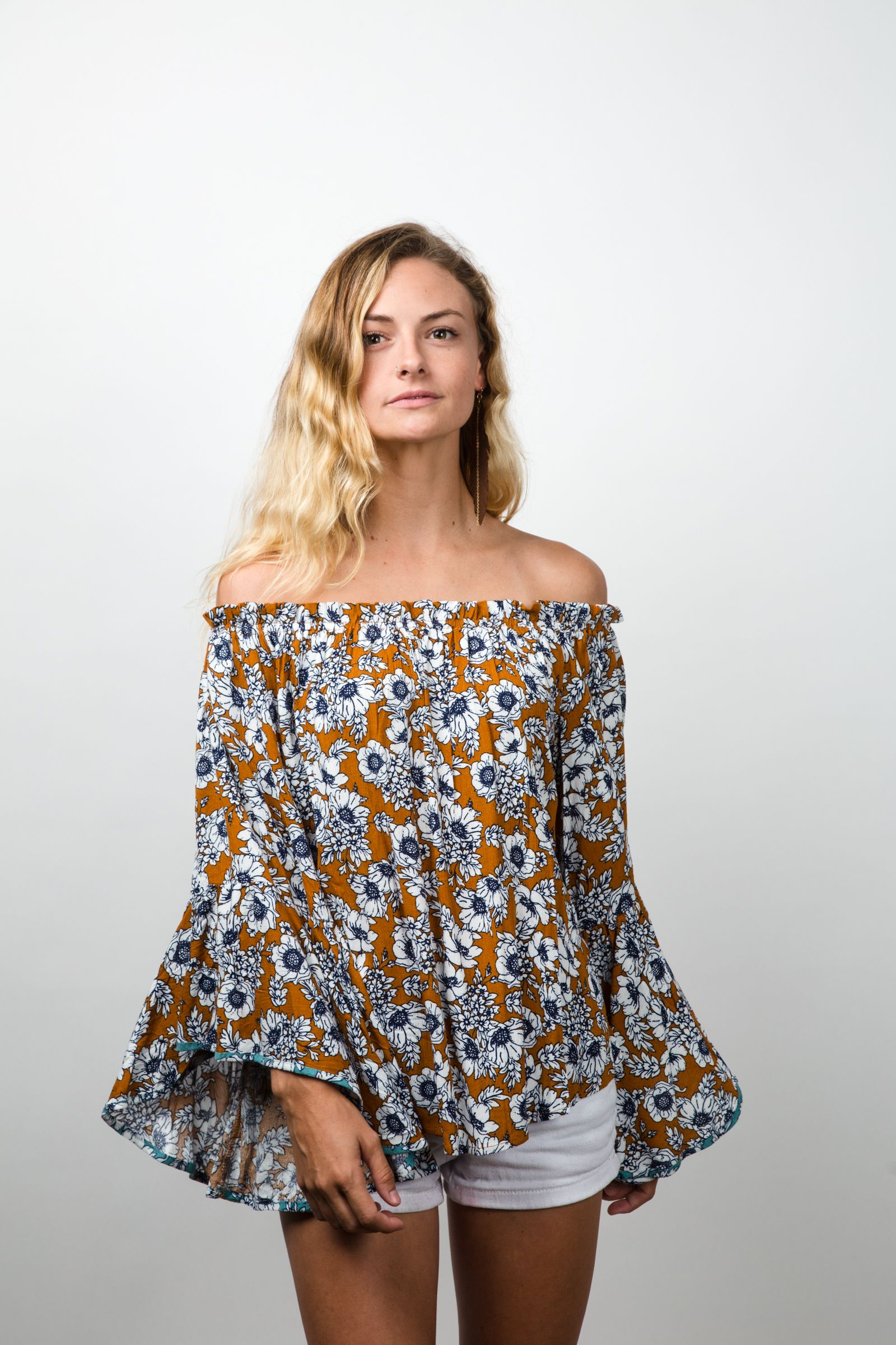 Stay fashionable and cool in this off the shoulder breezy top! This floral  blouse features on-trend bell sleeves with gathered elastic off the  shoulder neck ... 637ca36d5