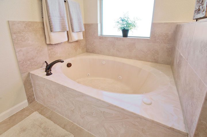 Example Of Garden Tub With Cultured Marble Bathrooms Remodel