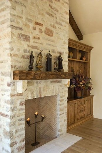 HARD WOOD FLOOR, STONE FIREPLACE, built in CABINETS, and statuary in