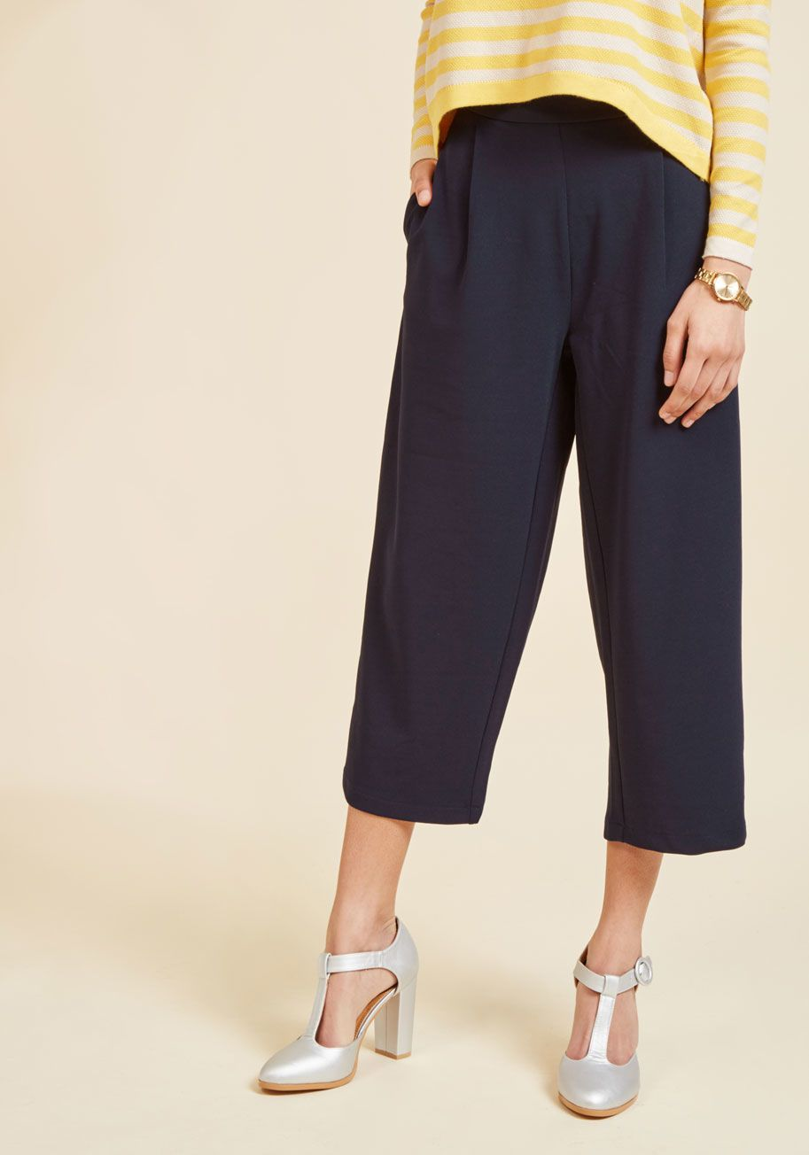 <p>With sleek vertical seams and a cool, cropped cut, these navy culottes promise to polish up any look you choose with the utmost ease! Sleek side pockets and a high-waisted silhouette also permit this pair to go the extra mile in creating new outfit favorites. Talk about an ensemble job well done!</p>