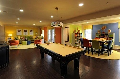 family room for teens with crafts table and storage pool table and