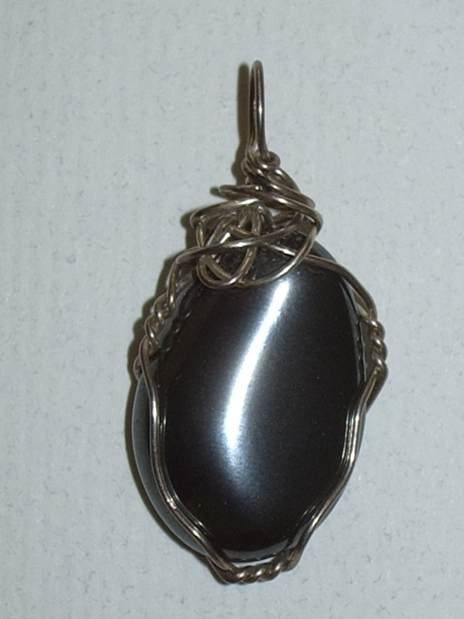 Hematite pendant wire wrapped 925 sterling silver this rich and attractive stone is a uniform dark metallic gray in color aloadofball Images