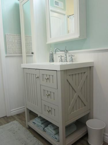 The Sharkey Gray Color Of This Seal Harbor Bathroom Vanity Looks So Elegant Next To Mint Green Walls Home Depot Customer S Remodel