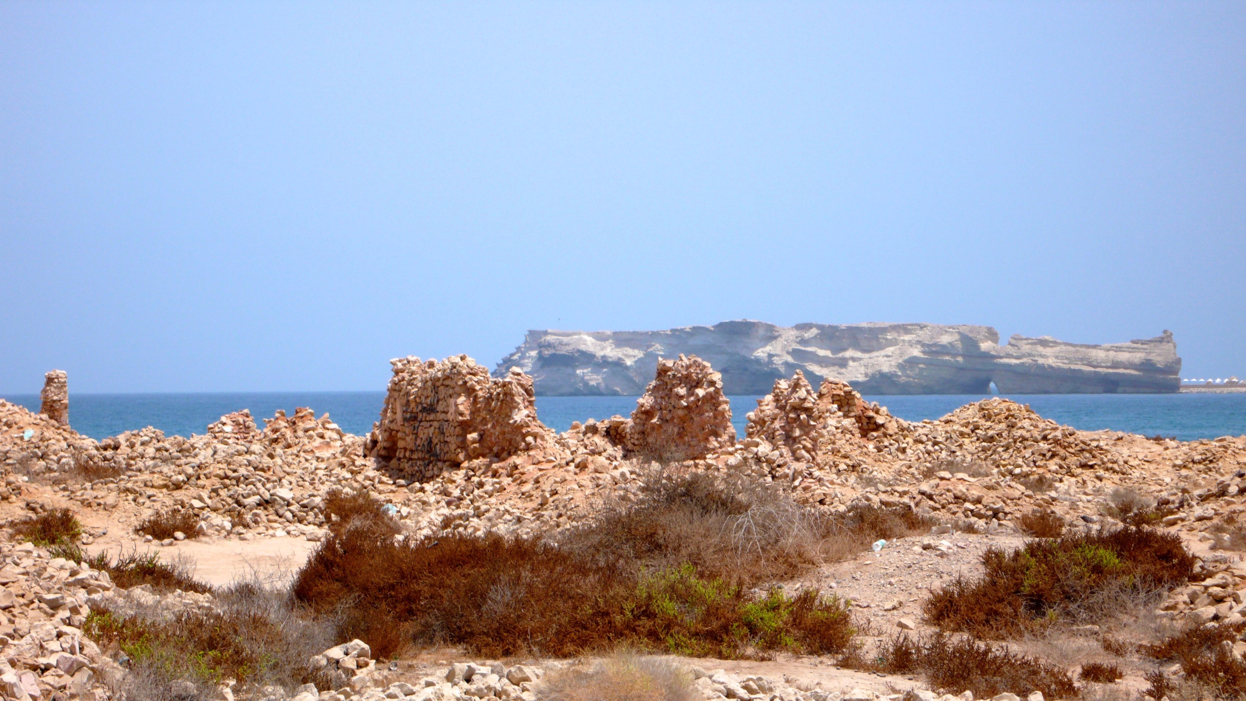 Remains of a leper colony on a beautiful beach known by expats as 'Martini beach' in Oman.