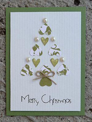 home made christmas card i like the idea of the heart shapes coming