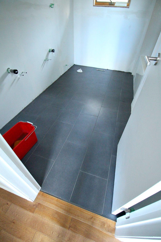Charcoal grey large rectangular bathroom floor tile with ...