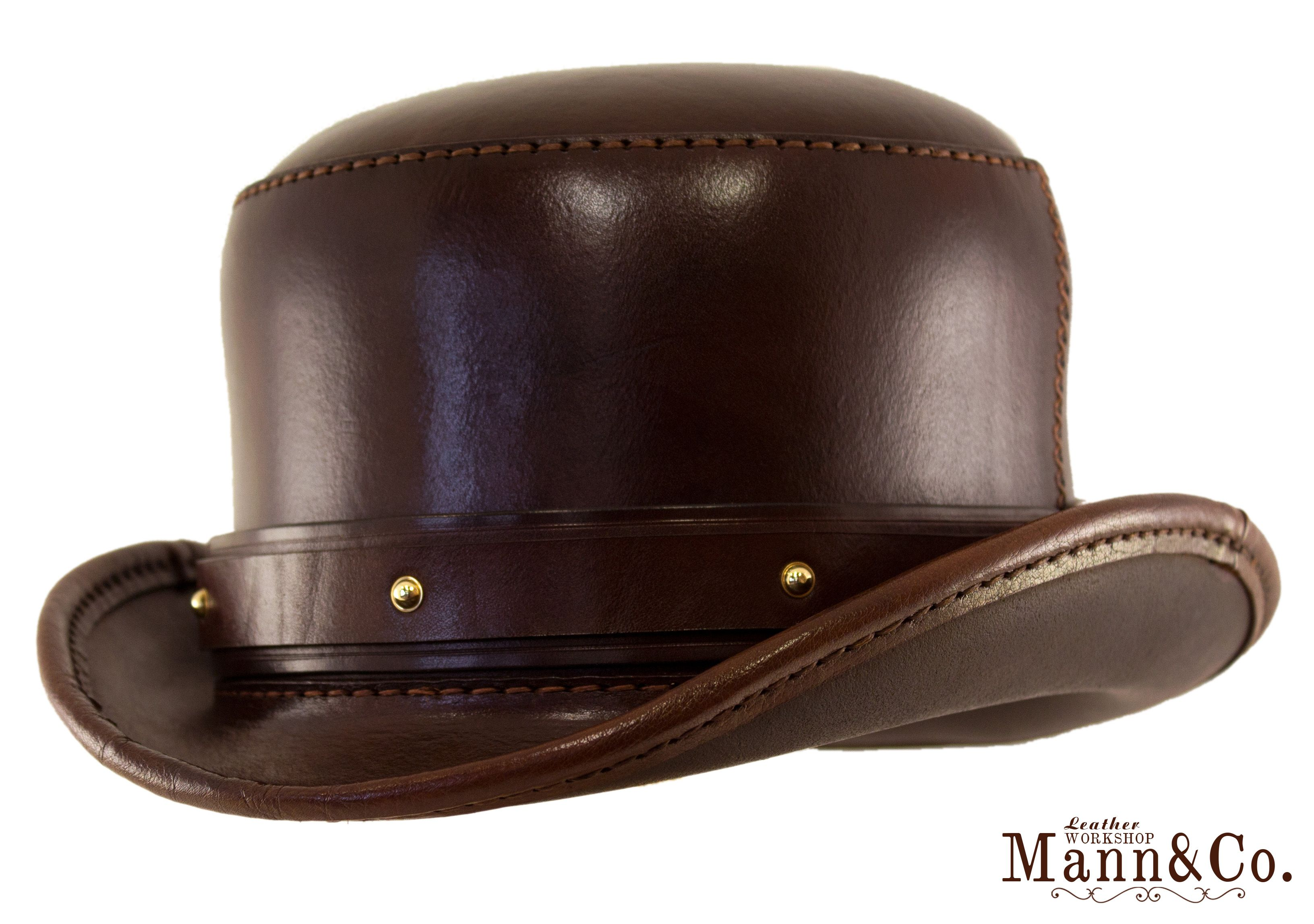 379340b1d3 A Bowler hat in veg-tan leather.