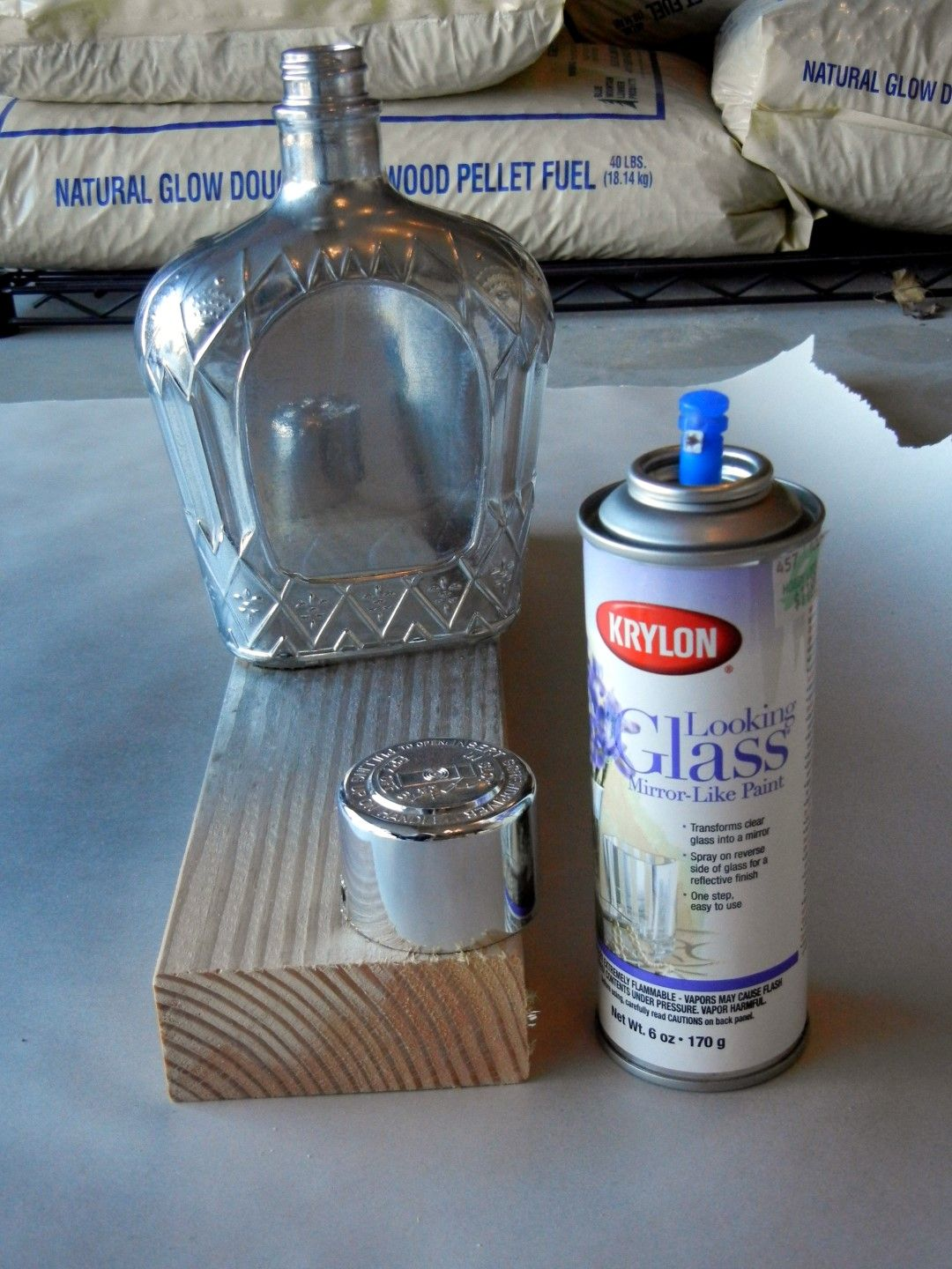 Painted liquor bottle and then upcycle it into a vase or a for Liquor bottle vases
