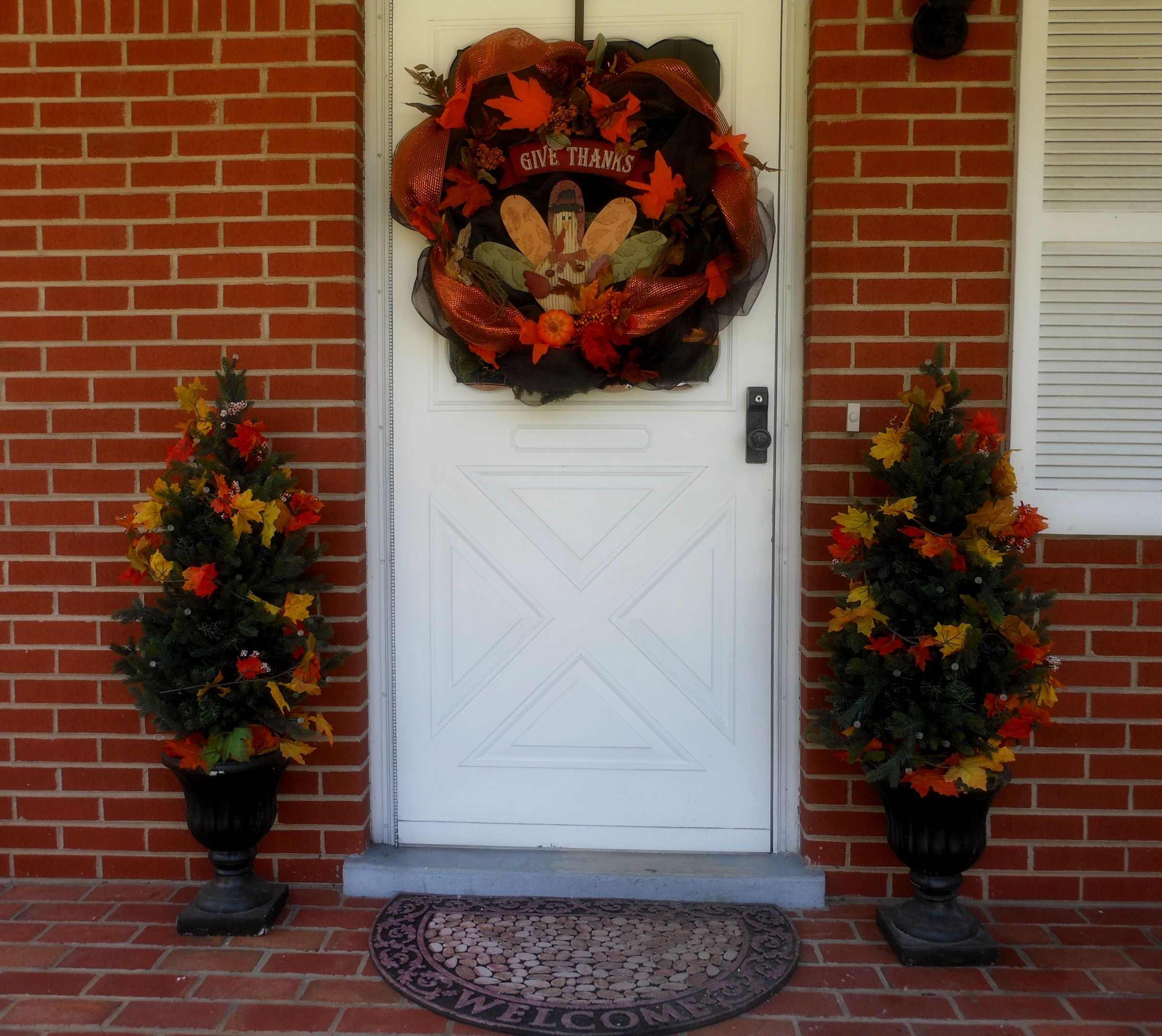 Bethlehem lights wreath battery operated - Front Door Decorated For Fall Autumn With Bethlehem Lights Wreath And Urn Trees That Are