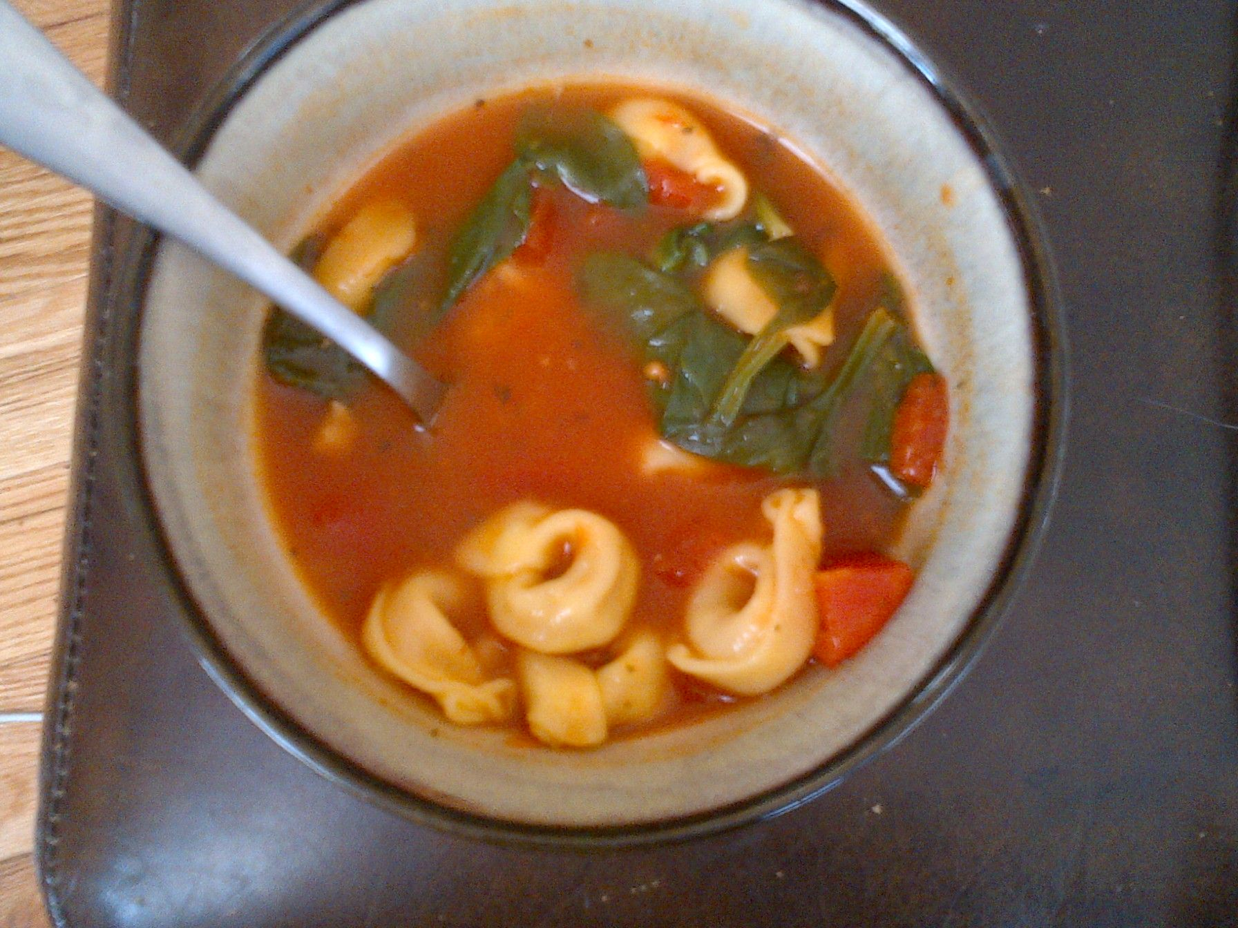 Tomato Spinach Tortellini Soup  32oz of Chicken Broth  1 Can oz diced tomatoes  A handful of dried tortellini  A few handfuls of baby spinach at the end.   SO DELICIOUS
