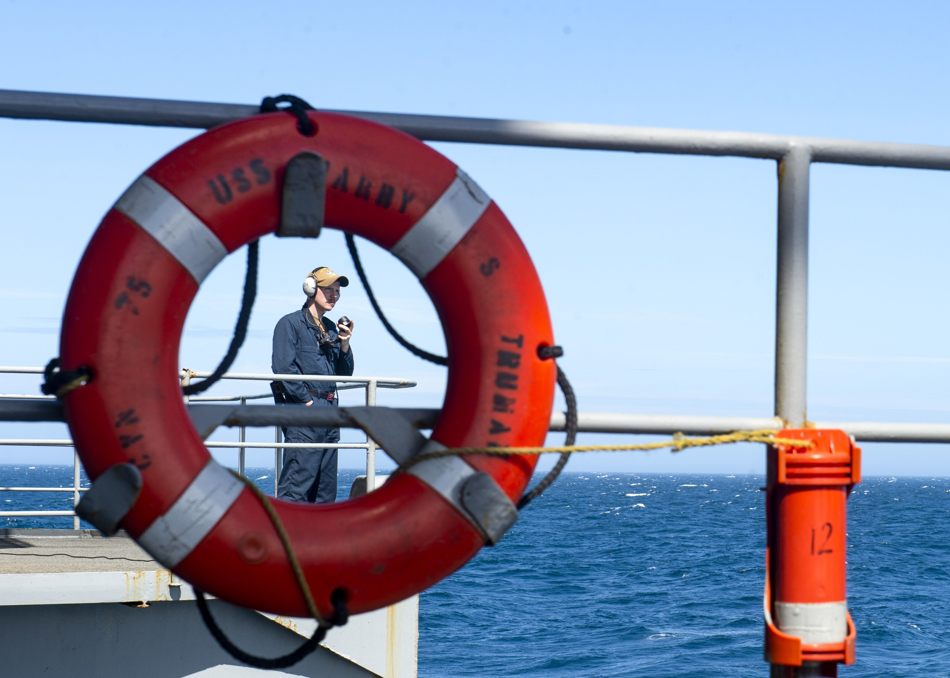 A seaman stands watch on the fantail of the nimitzclass