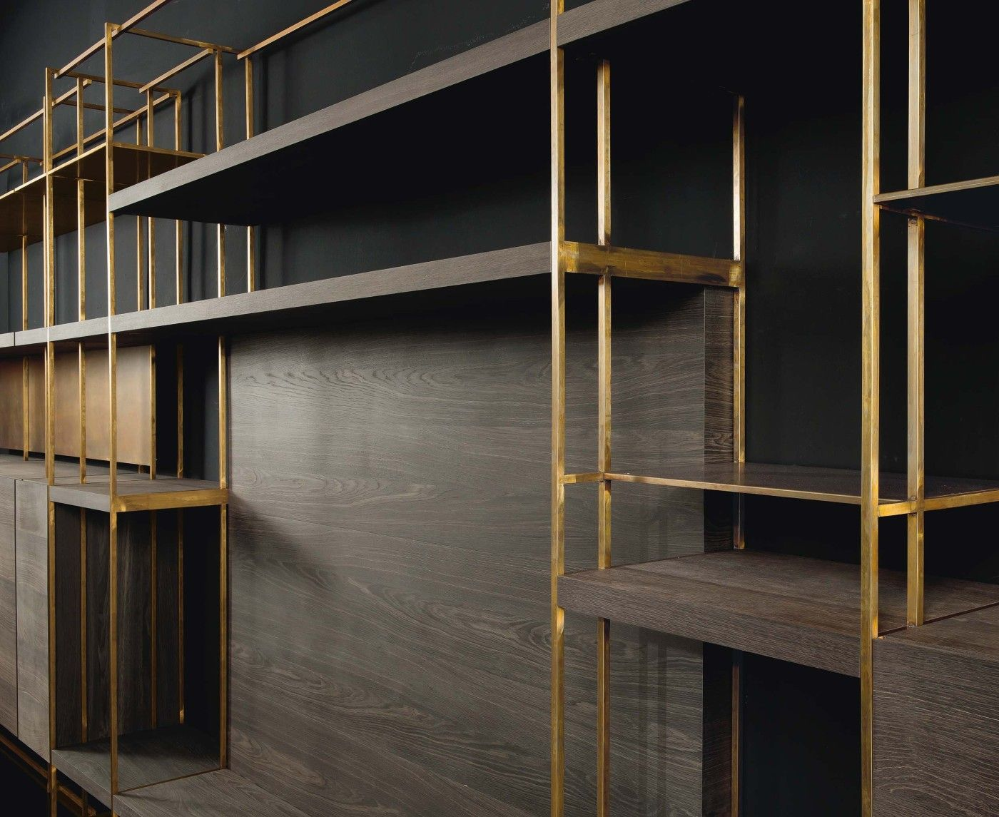 double depth bookshelf structure square brass pipe structure  x . double depth bookshelf structure square brass pipe structure