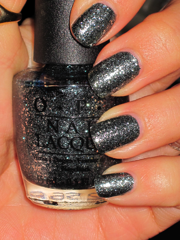 Opi Ulta Exclusive Holiday Colors How S It Snowin Gunmetal Greyish Color With Hints Of Black And Tons Silver Multi Shaped Glitter That Gives