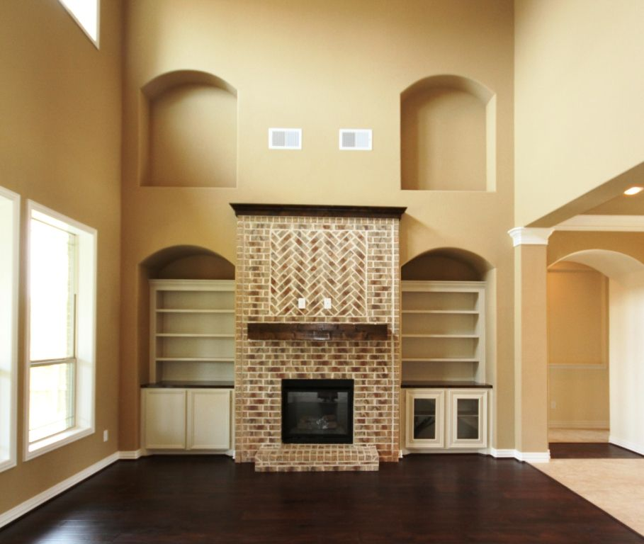 Stone Fireplace With Built In Cabinets: Kinsmen Home Katherine Two Story Living Room With An Eye
